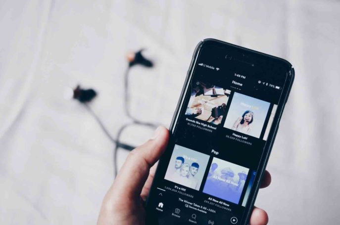 A person downloaded free music on the smartphone and looking at it.